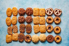 Different types of bisquits as a frame on vintage background royalty free stock photo
