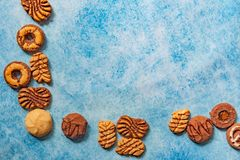 Different types of bisquits as a frame on vintage background stock photo