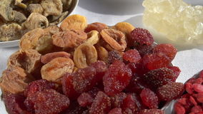 Different Types of Dried Fruits. Past the camera slowly moving small plates with different kinds of dried fruits and nuts stock video