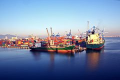 Different types of dry cargo, passenger and container vessels in motion and moored at the port of Izmir, Turkey. Different types of dry cargo, passenger and stock photography