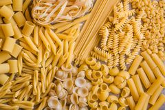 Various types of dry pasta. Different types of dry pasta: spaghetti, penne, fusilli and others Royalty Free Stock Images