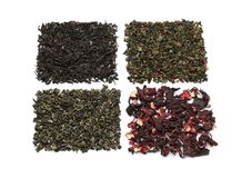Different types of dry tea leaves on white background royalty free stock photos