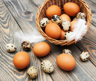 Different types of eggs in a basket Stock Photos