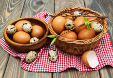 Different types of eggs in a basket Royalty Free Stock Image