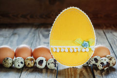 Different types of eggs and  easter card  on  wooden background Stock Photography