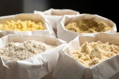 Different types of flour in bags. Different types of flour in paper bags royalty free stock images