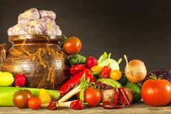 Different types of fresh vegetables on a wooden table. Harvesting vegetables on a farm. Healthy food. Different types of fresh vegetables on a wooden table Royalty Free Stock Photo
