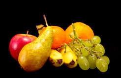Different types of fruit. On a black background royalty free stock image
