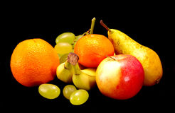 Different types of fruit. On a black background royalty free stock photo