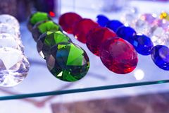 Different types of gems stones in the showcase of the shop in Barcelona, Catalonia, Spain. 2019-05-01.  stock photos