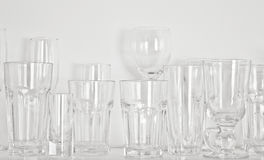 Different types of glasses. On the shelf Stock Photo