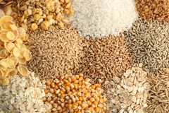 Different types of grains and cereals. As background Stock Photos