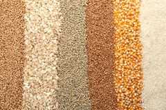 Different types of grains and cereals. As background Royalty Free Stock Photos
