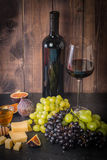 Different types of grapess with bottle of wine Stock Image