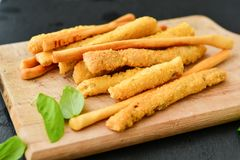 Grissini. Different types of grissini - tradition Italian breadsticks and salami. Mediterranian lunch stock photography