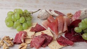 Different types of ham on vintage background stock footage