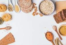 Different types of high carbohydrate food on the white background. Different types of high carbohydrate food. Flour, pasta, oatmeal and other ingredients on the royalty free stock photography