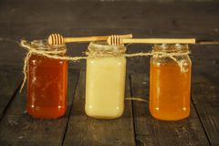 Different types of honey in glass jar on wooden rustic background. Honey in a glass jar. Honey is a healthy diet. Different types of honey in glass jar on royalty free stock photography
