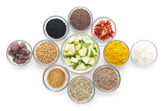 Different types of Indian spices in glass bowls. Stock Photos