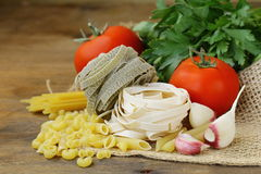 Different types of Italian pasta with tomatoes Stock Photography