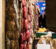 Different types of Italian salami. Hanging in a restaurant Stock Image