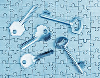 Different types of keys on the puzzle. Stock Photography