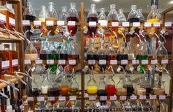 Different types of liqueur in unique bottles. Different types of homemade liqueur in beautiful and unique bottles royalty free stock photos