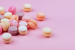 Different types of macaroons on pink background. Royalty Free Stock Image