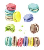 Different types of macaroons. Sweet and colorful set of hand painted watercolor macaroons isolated on white background Royalty Free Stock Photography