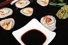 Different types of maki rolls on black Stock Image
