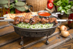 Different types of meat prepared on grill. With vegetables Stock Photo