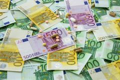 Medicines and the euro. Different types of medicines with a banknote background, many types of medicines lie on euro banknotes Royalty Free Stock Image