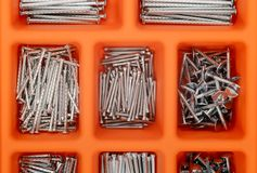 Different types of nails in a plastic box. Royalty Free Stock Images