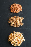 Different types of nuts on black background.  Royalty Free Stock Photography