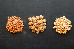 Different types of nuts on black background.  Stock Photos