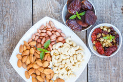 Different types of nuts and dried fruits Stock Photos