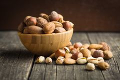 Different types of nuts in the nutshell. Stock Photography