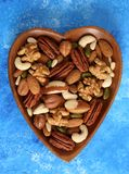 Different types of nuts in wooden bowl. royalty free stock photo
