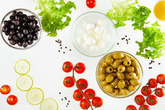 Different types of olives and mozzarella with cherry tomatoes Stock Image