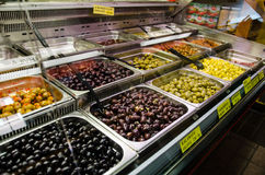 Different types of olives in a shop. Different types of olives in a refrigerator shop Stock Image