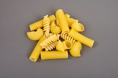 Different types of pasta isolated on grey stock photo