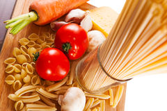 Different types of pasta and vegetables Stock Image