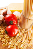Different types of pasta and vegetables Stock Images