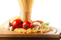 Different types of pasta and vegetables Royalty Free Stock Photo
