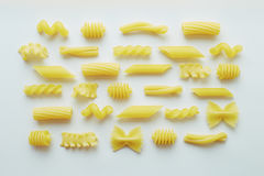Different types of pasta on white background. Wallpaper royalty free stock photo
