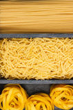 Different types of pasta in the wooden box Royalty Free Stock Photography