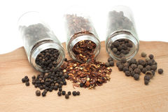 Different types of pepper. Three different types of pepper on a white background Stock Images