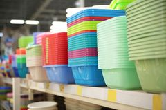 Different types of plastic bowls. In supermarket stock photo