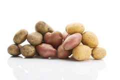 Different types of potatoes on white background stock images