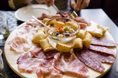 Different types of prosciutto and salami. Different types of prosciutto, parmigiana and salami- Parma meats platter at restaurant royalty free stock photo